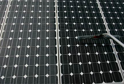 solar panel being cleaned